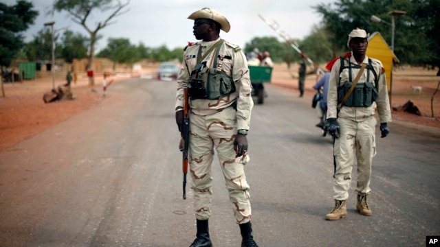 Malian soldiers man a checkpoint on the Gao road outside Sevare, some 620 kilometers (385 miles) north of Mali's capital Bamako,  Jan. 27, 2013.