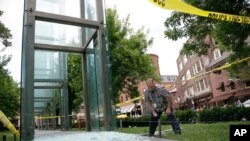 "Bill Satterlund, facilities manager for Combined Jewish Philanthropies of Boston, begins to pick up broken glass from one of the Holocaust Memorial's glass panels shattered with a rock thrown shortly before 2 a.m., June 28, 2017. The memorial is designed around six luminous glass towers, which symbolize the 6 million Jews killed in the Holocaust, the names of the six main death camps, and the six years during which Adolf Hitler's ""Final Solution"" took place from 1939 to 1945."