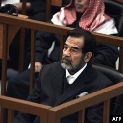 Saddam Hussein in November 2006 during his and other Iraqi officials' trial for genocide against Kurds. Prosecutors said about 180,000 people, mostly civilians, were killed in the campaign.