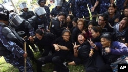 Nepal police stop a gathering of exile Tibetans who were shouting anti-China slogans in tribute to the Tibetans who died in the recent self-immolation, in Katmandu, Nepal, Tuesday, Nov. 1, 2011