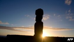 FILE - View of a Moai – stone statue of the Rapa Nui culture – on the Tahai site on Easter Island, 3700 km off the Chilean coast in the Pacific Ocean, on August 12, 2013.