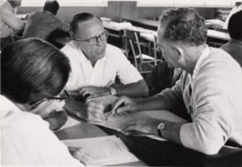 Eugene Nida sits at center in this photograph from the American Bible Society.