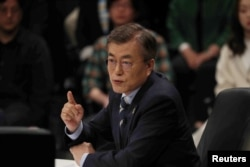 FILE - Moon Jae-in, the presidential candidate of the Democratic Party of Korea, speaks during a televised debate in Goyang, South Korea, April 25, 2017.