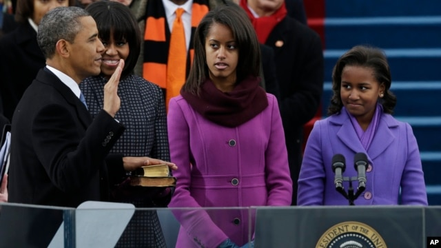 President Barack Obama's family watches during the ceremonial swearing-in at the U.S. Capitol during the 57th Presidential Inauguration in Washington, Jan. 21, 2013.