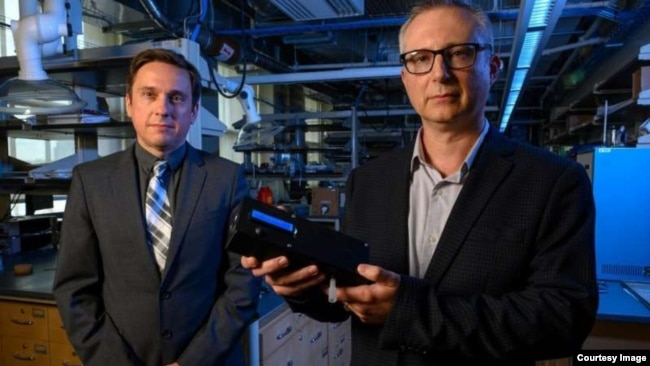 A prototype of a marijuana breathalyzer device developed researchers from the University of Pittsburgh is shown. The device is presented by Ervin Sejdic, (left) PhD, an associate professor of electrical and computer engineering at the Swanson School.