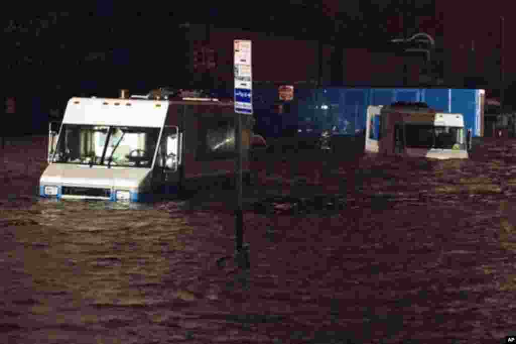 Consolidated Edision trucks are submerged on 14th Street near the ConEd power plant, October 29, 2012, in New York. Sandy knocked out power to at least 3.1 million people.