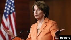 """U.S. House Minority Leader Nancy Pelosi speaks to reporers. Sharp differences remained between congressional Republicans and the White House in talks to avert the """"fiscal cliff,"""" Dec. 14, 2012."""