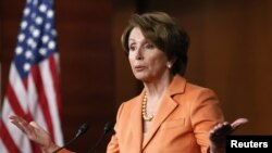 FILE - U.S. House Minority Leader Nancy Pelosi speaks to reporters.