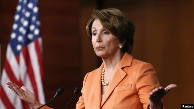 FILE - U.S. House Minority Leader Nancy Pelosi speaks to reporters.