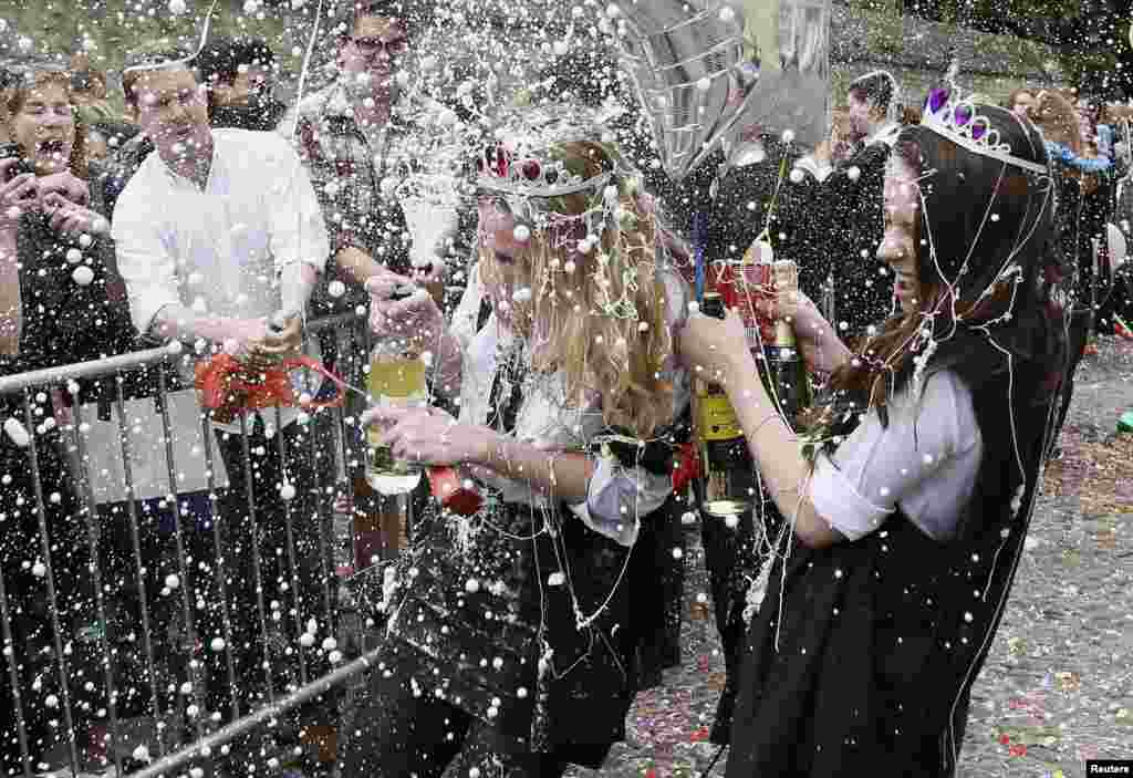 "Students from University College Oxford gets ""trashed"" after finishing their exams in Oxford, southern England. Trashing is a practice at Oxford University where students have messy items thrown at them by their contemporaries after finishing their exams."