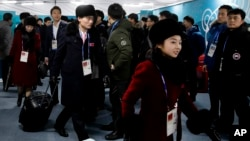 Members of the North Korean Olympic delegation arrive at the Olympic Village of the 2018 Winter Olympics in Gangneung, South Korea, Feb. 1, 2018. (AP Photo/Charlie Riedel)