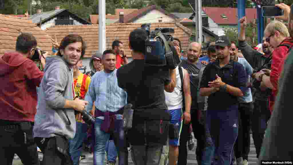 Refugees said they hope the large media presence at this border will encourage authorities to let them pass on their way to Western Europe, at Harmica, Croatia, Sept. 20, 2015.