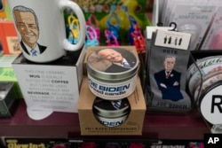 A display of President-elect Joe Biden and Jill Biden books and keepsakes including a scented candle, are available at Browseabout Books, Friday, Nov. 13, 2020, in Rehoboth Beach, Del. (AP Photo/Alex Brandon)
