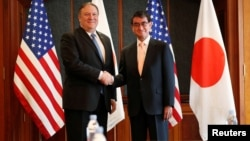 U.S. Secretary of State Mike Pompeo shakes hands with Japan's Foreign Minister Taro Kono during a bilateral meeting at a hotel in Seoul, South Korea, June 14, 2018.