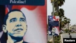 ຊາວປະແລສຕາຍ ຄົນນຶ່ງຢ່າງຜ່ານໃກ້ບ່ອນ ທີ່ທ່ານ Barack Obama ຈະໄປຢ້ຽມຢາມໃນເມຶອງ Ramalla, West Bank