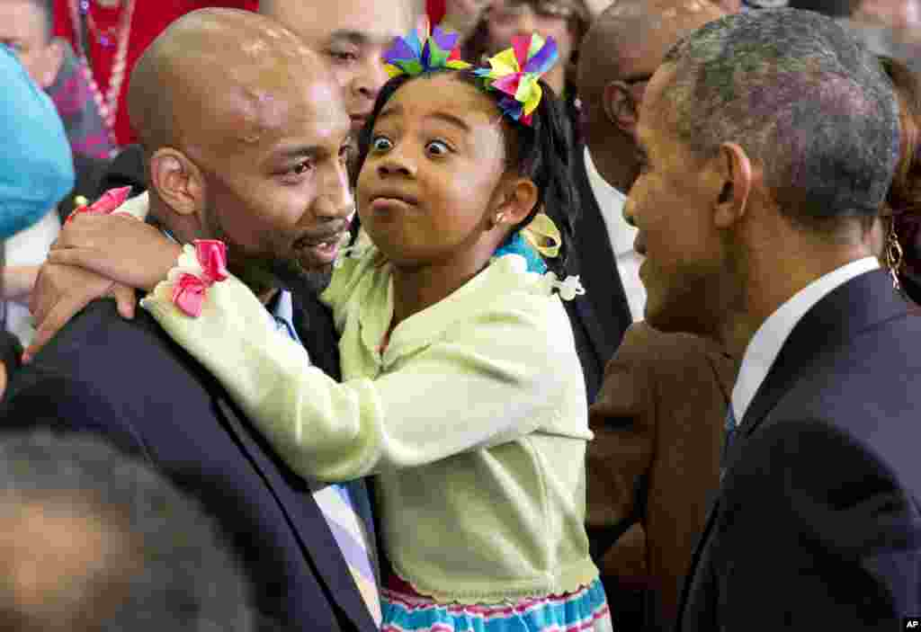 A girl reacts as President Barack Obama greets her and others in the crowd after speaking about payday lending, at Lawson State Community College in Birmingham, Ala., March 26, 2015.