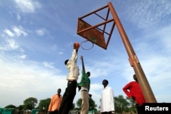 FILE - A basketball team plays a game in the town of Turalei in Warap state, southern Sudan.