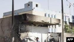 Prizor sa jednog od mesta na kojima su izvršeni bombaški napadi u Bagdadu, 12. oktobar 2011.