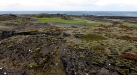 Volcanic rocks are seen at the Golfklubberinn Oddur golf course, near Rekyavik, June 5, 2013. The lava beds dominate the rough on many courses, and the beds are filled with crevices that swallow mis-hit golf balls.
