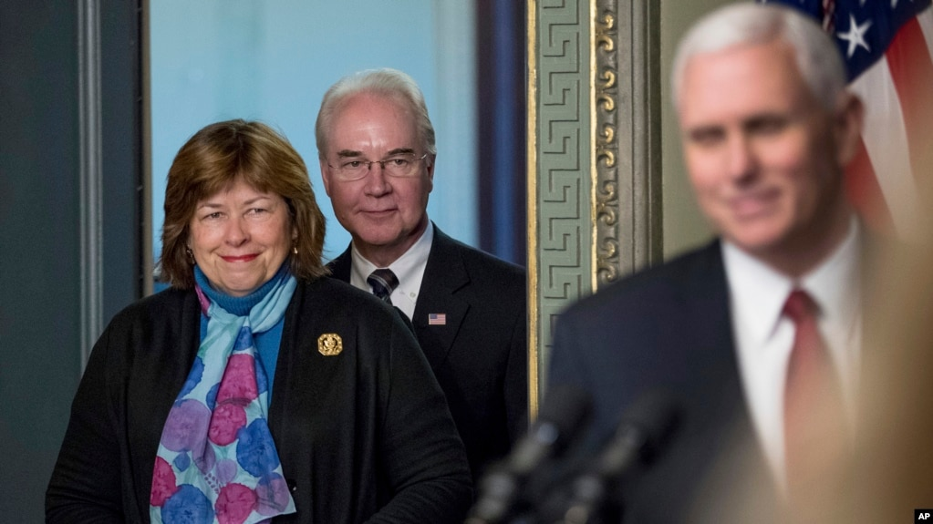 Vice President Mike Pence takes the podium to speak at a swearing in ceremony for Health and Human Services Secretary Tom Price, accompanied by his wife Betty, Feb. 10, 2017, in the in the Eisenhower Executive Office Building in Washington.