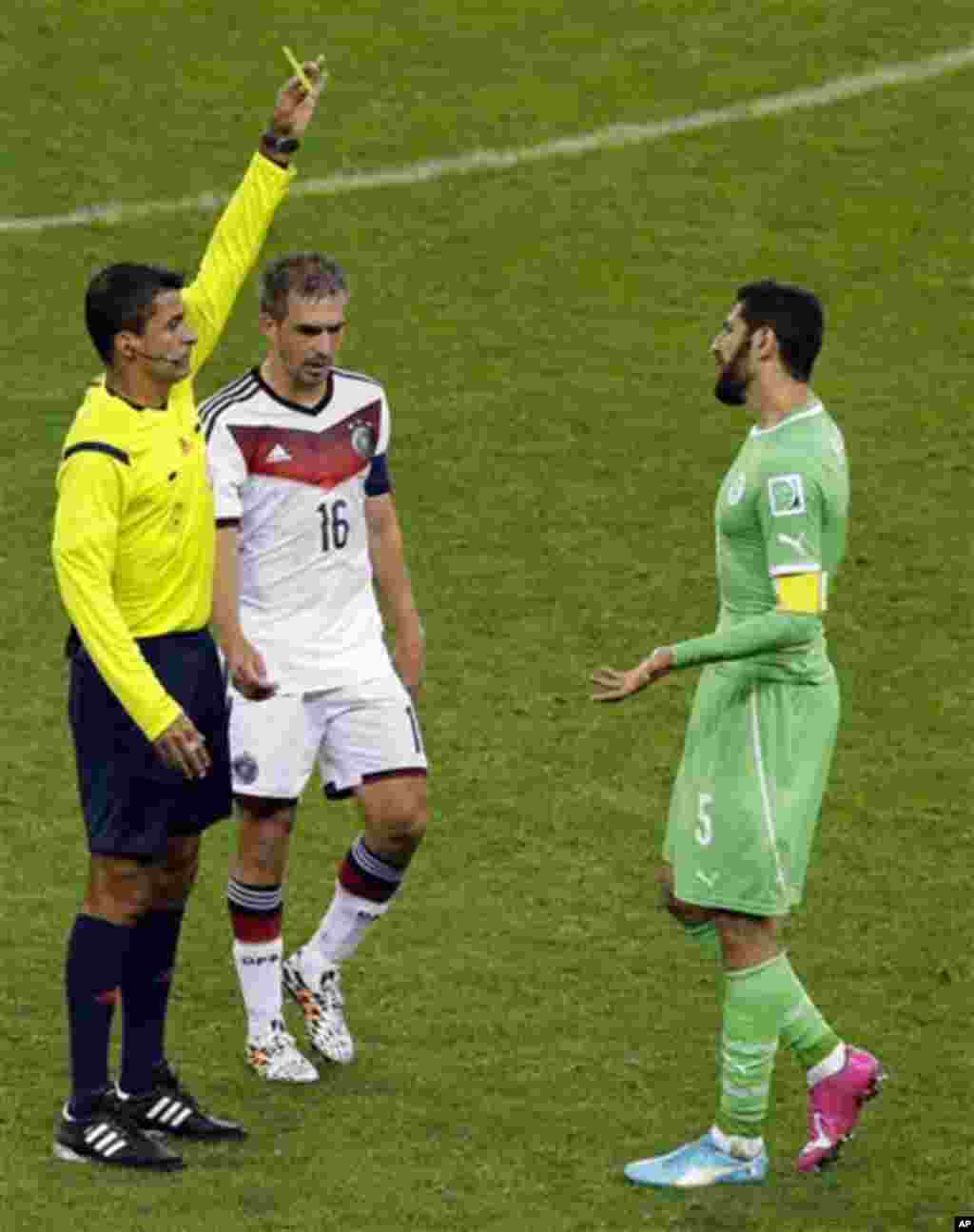 Algeria's Rafik Halliche, right, is booked by referee Sandro Ricci from Brazil during the World Cup round of 16 soccer match between Germany and Algeria at the Estadio Beira-Rio in Porto Alegre, Brazil, Monday, June 30, 2014. Between them is Germany's Phi