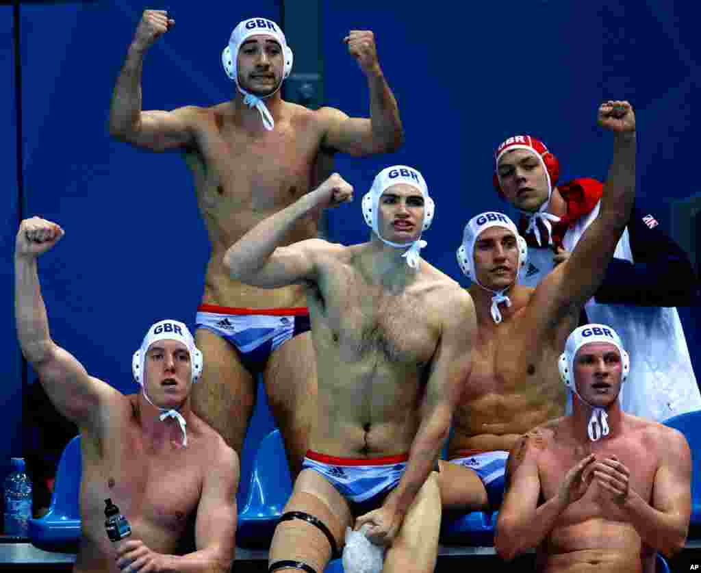 Britain's water polo players react to a goal by Glen Robinson during a preliminary men's match against Montenegro.