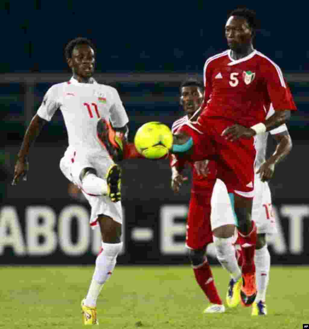 "Jonathan Pitroipa of Burkina Faso (R) fights for the ball with Ala'a Eldin Yousif of Sudan during their African Nations Cup Group B soccer match at Estadio de Bata ""Bata Stadium"", in Bata January 30, 2012."