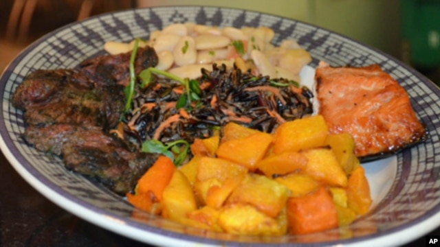 The sampler plate at the American Indian museum contains grilled bison and salmon,  roasted butternut squash, wild rice salad, and Peruvian lima bean salad.