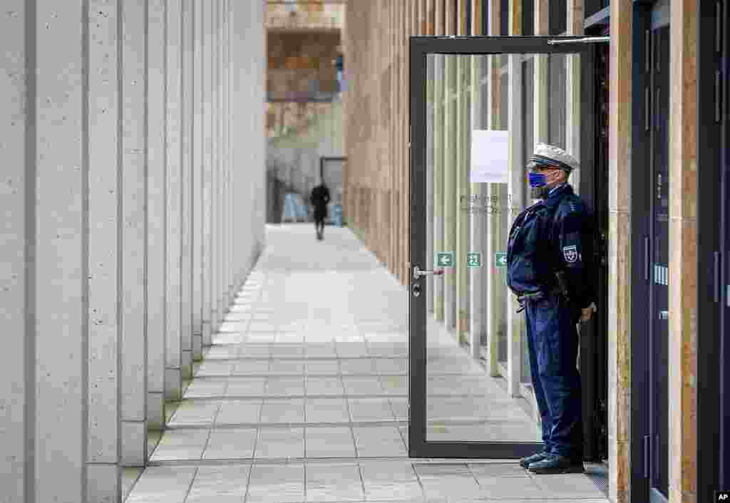 A police officer guards the entrance of a vaccine center in Wiesbaden, Germany.
