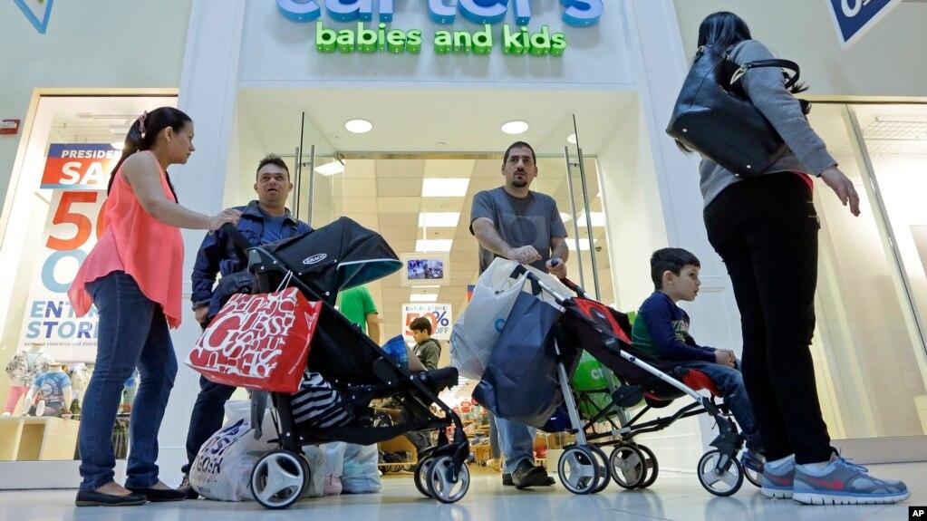 FILE - Shoppers walk through a mall in Miami, Florida, Feb. 12, 2016.
