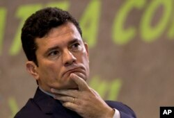 FILE - Former Judge Sergio Moro participates in an anti-corruption conference in Rio de Janeiro, Brazil, Nov. 23, 2018.