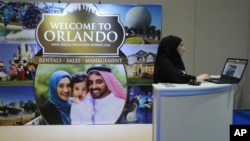 An exhibitor works at an American Halal Vacation Homes booth at The World Halal Travel Summit & Exhibition in Abu Dhabi, United Arab Emirates, October 19, 2015.
