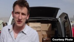 FILE - Abdul-Rahman (Peter) Kassig, an American aid worker, making a food delivery to refugees in Lebanon's Bekaa Valley, May 2013. Kassig is a being held captive by Islamic State militants. (Courtesy of Kassig family)