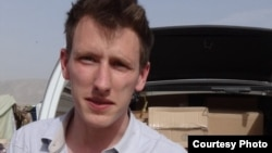 FILE - Abdul-Rahman (Peter) Kassig, an American aid worker, is seen making a food delivery to refugees in Lebanon's Bekaa Valley, May 2013. (Courtesy of Kassig family)