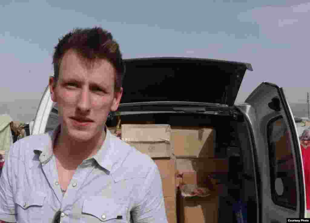 Abdul-Rahman (Peter) Kassig, an American aid worker, making a food delivery to refugees in Lebanon's Bekaa Valley, May 2013. (Copyright, with permission to use from Kassig family)