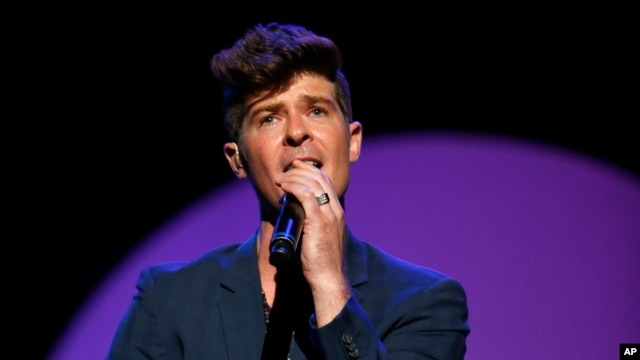 "Pop singer Robin Thicke's ""Blurred Lines,"" featuring T.I. and Pharrell Williams was a top seller on iTunes for the week ending June 17."