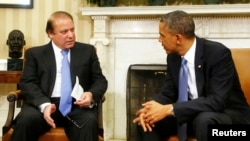 U.S. President Barack Obama speaks with Pakistan's Prime Minister Nawaz Sharif during their meeting at the White House.