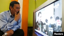An man watches television in Baghdad, Iraq (file photo).