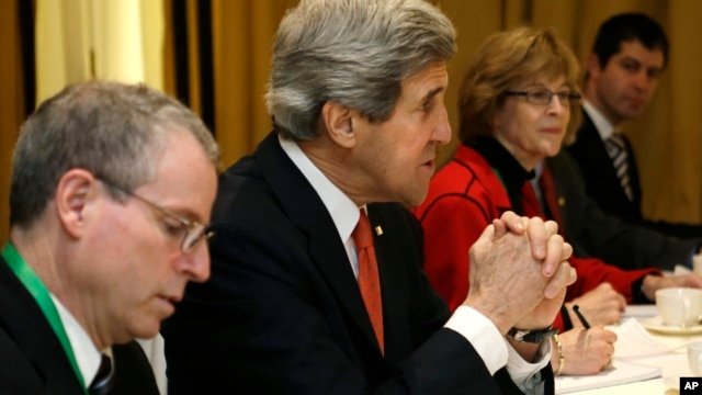 U.S. Secretary of State John Kerry, second from left,  meets with leaders of the Syrian Opposition Coalition at the Hotel Excelsior in Rome, February 28, 2013.