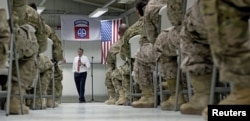 FILE - U.S. Defense Secretary Ash Carter talks to U.S. troops from the 82nd Airborne Division at the Baghdad International Airport in Baghdad, Iraq, July 23, 2015.