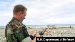 File -- Navy Chief Warrant Officer Paul Patterson calculates coordinates for a potential amphibious landing zone near Makuto, Venezuela, Jan. 3, 2000.