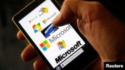 A Nokia Lumia 820 smartphone with Microsoft logos on the screen is shown in a photo illustration taken in the central Bosnian town of Zenica, Sep. 3, 2013.