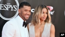 FILE - NFL football player Russell Wilson, of the Seattle Seahawks, left, and Ciara arrive at the ESPY Awards at the Microsoft Theater in Los Angeles.