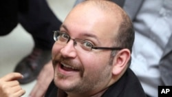FILE - Jason Rezaian, an Iranian-American correspondent for The Washington Post, is pictured at a campaign event for President Hassan Rouhani in Tehran, April 11, 2013.
