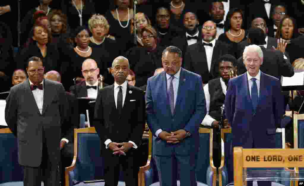 Louis Farrakhan, from left, Rev. Al Sharpton, Rev. Jesse Jackson and former President Bill Clinton attend the funeral service for Aretha Franklin at Greater Grace Temple in Detroit.