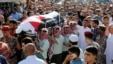 FILE - Jordanian soldiers and relatives of one of the solders killed in an attack on a border military post near a camp for Syrian refugees, carry his body during his funeral at Nahleh village, north of Amman, Jordan, June 2, 2016.