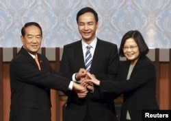 FILE - James Soong (L) shakes hands with Tsai Ing-wen(R) and Eric Chu before a televised debate ahead of the 2016 presidential election at the Taiwan Public Television Service station in Taipei, Taiwan, Dec. 27, 2015.