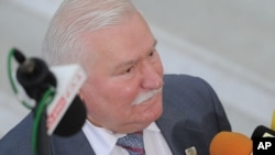 FILE - Former Polish President Lech Walesa speaks to journalists, in Warsaw, Poland, Aug. 6, 2015. Allegations that former president Lech Walesa was a communist-era secret informer have resurfaced after prosecutors seized documents illegally held by a former official's family.