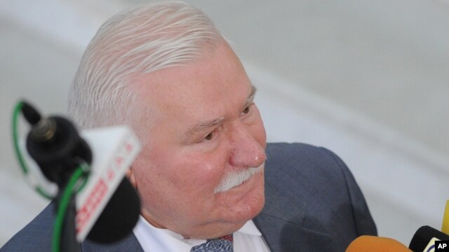 FILE - Former Polish President Lech Walesa speaks to journalists, in Warsaw, Poland,  Aug. 6, 2015. Walesa denies he informed on people to the communist regime or took money from the secret security services.