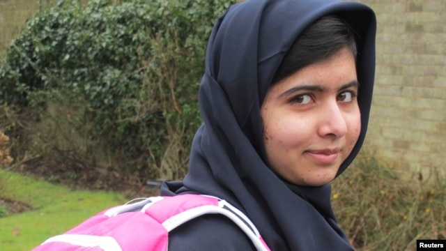 FILE - Malala Yousufzai smiles as she attends school in Edgbaston, central England, in this handout photograph released March 19, 2013.